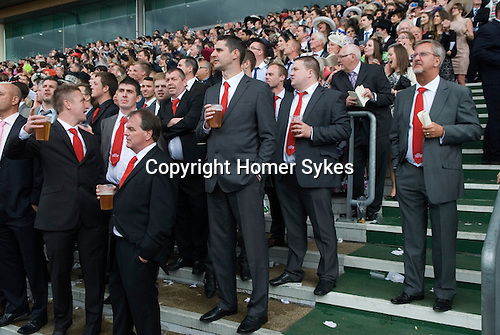 "Royal Ascot horse racing Berkshire. 2012 Group of men wearing red ties that say "" Horners Stag Do 2012"""