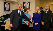 Washington, DC - December 22, 2008 -- United States President George W. Bush, left, points to Sherri Lewis Wood, center, national coordinator of the charity program One Warm Coat, as first lady Laura Bush, second left, and Washington Mayor Adrian Fenty, right, look on Monday, December 22, 2008 in Washington, DC. White House personnel donated more than 100 winter coats to the program as part of the Holiday Service Project..Credit: Mike Theiler - Pool via CNP