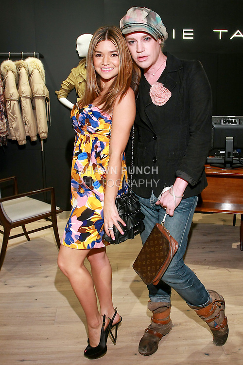 Erin Rosenberg and Richie Rich attend the Elie Tahari Boutique opening at Saks Fifth Avenue, October 19, 2010.