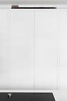 A flush white kitchen cupboard