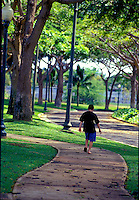 Boy walking home in residential area of Oahu