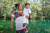 Angeles with her son Angel at a Cenote (sink hole) at Tankah a recreated Mayan Village. Tulum, Quintana Roo, Mexico