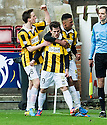 East Fife's Liam Buchanan (19) celebrates with Lewis Barr (8) and Nathan Austin after he scores their first goal from the penalty spot.