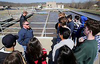 NWA Democrat-Gazette/DAVID GOTTSCHALK Tom Moore (left), a class 1 waste water operator at the Rogers Pollution Control Facility, leads a tour Thursday, March 1, 2018, of junior and senior Environmental Science Class students from Rogers Heritage High School at the facility. The students also toured the Illinois River Watershed Sanctuary and Watershed Learning Center in Cave Springs.