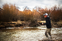 A fly fisherman cast a streamer on a small western Montana creek.
