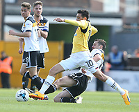 Bolton Wanderers' Jem Karacan is tackled by Port Vale's Danny Pugh<br /> <br /> Photographer Stephen White/CameraSport<br /> <br /> The EFL Sky Bet League One - Port Vale v Bolton Wanderers  - Saturday 22nd April 2017 - Vale Park - Burslem<br /> <br /> World Copyright &copy; 2017 CameraSport. All rights reserved. 43 Linden Ave. Countesthorpe. Leicester. England. LE8 5PG - Tel: +44 (0) 116 277 4147 - admin@camerasport.com - www.camerasport.com