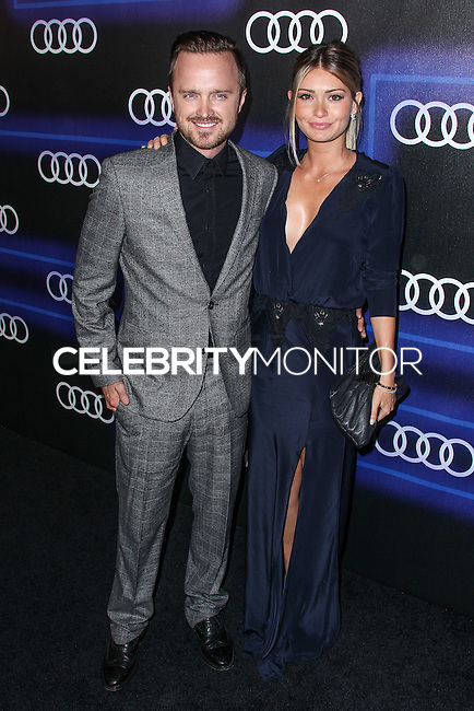 WEST HOLLYWOOD, CA, USA - AUGUST 21: Aaron Paul, Lauren Parsekian  arrive at the Audi Emmy Week Celebration held at Cecconi's Restaurant on August 21, 2014 in West Hollywood, California, United States. (Photo by Xavier Collin/Celebrity Monitor)