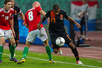Hungary's Jozsef Varga (2nd R) and Netherlands' Jeremain Lens (R) fight for the ball during a World Cup 2014 qualifying soccer match Hungary playing against Netherlands in Budapest, Hungary on September 11, 2012. ATTILA VOLGYI