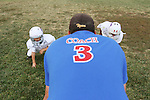 CHAD PILSTER &bull;&nbsp;Hays Daily News<br /> <br /> Josh Waddell, a coach, runs a drill on Tuesday, September 10, 2013, during practice of the third grade Gamblers of the Hays Football Association  at Aubel-Bickle Park in Hays, Kansas.