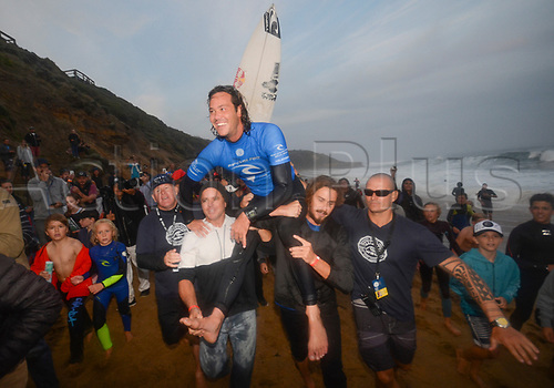 April 19th Bells Beach, Melbourne, Victoria, Australia; Rip Curl Pro Bells Beach Surfing; Jordy Smith (ZAF) is carried from the beach after winning the 2017 Bells Beach Rip Curl Pro; Smith defeated Caio Ibelli (BRA)