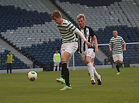 Stuart Findlay clears under pressure from Blair Henderson in the Dunfermline Athletic v Celtic Scottish Football Association Youth Cup Final match played at Hampden Park, Glasgow on 1.5.13. ..