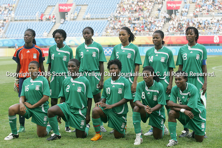 09 August 2008: Nigeria starting eleven.  Front row (l to r): Ulunma Jerome (NGR), Efioanwan Ekpo (NGR), Rita Chikwelu (NGR), Ifeanyi Chiejine (NGR), Cynthia Uwak (NGR).  Back row (l to r): Precious Dede (NGR), Perpetua Nkwocha (NGR), Sarah Michael (NGR), Onome Ebi (NGR), Faith Ikidi (NGR), Christie George (NGR).  The women's Olympic soccer team of Germany defeated the women's Olympic soccer team of Nigeria 1-0 at Shenyang Olympic Sports Center Wulihe Stadium in Shenyang, China in a Group F round-robin match in the Women's Olympic Football competition.