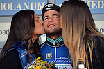 Omega Pharma-Quick Step rider Mark Cavendish accepts the kisses to celebrate victory for his team on the podium at the end of the 2014 Tirreno-Adriatico Team Time Trial running from Donoratico to San Vincenzo. 12th March 2014.      <br /> Photo: Gian Mattia D'Alberto/LaPresse/www.newsfile.ie