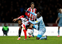 11th February 2020; Griffin Park, London, England; English Championship Football, Brentford FC versus Leeds United; Ethan Pinnock of Brentford challenges Jean-Kevin Augustin of Leeds United