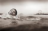 USA, California, portrait of girl lifeguard training, Santa Monica (B&W)
