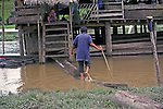 Native Ribereros returning to his home along a tributariry off the Peruvian Amazon.