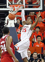 Virginia forward Akil Mitchell (25) dunks in front of North Carolina State forward T.J. Warren (24) during the game Saturday in Charlottesville, VA. Virginia defeated NC State 58-55.