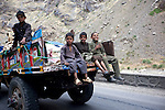 3 June 2013, Kabul - Jalalabad Road , Afghanistan.  Children ride on the back of a trailer on the road to Kabul from Jalalabad.  Picture by Graham Crouch/World Bank