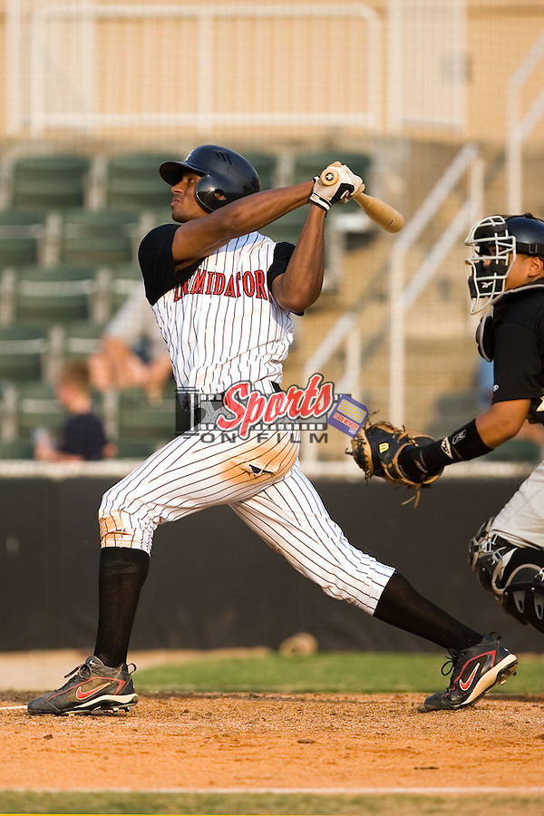 Center fielder Sergio Morales (15) of the Kannapolis Intimidators follows through on his swing at Fieldcrest Cannon Stadium in Kannapolis, NC, Sunday July 20, 2008. (Photo by Brian Westerholt / Four Seam Images)