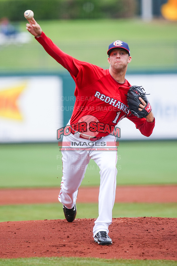 Jordan Lyles (14) in action during the MiLB matchup between the Memphis Redbirds and the Oklahoma City Redhawks at Chickasaw Bricktown Ballpark on April 8th, 2012 in Oklahoma City, Oklahoma. The Redhawks defeated the Redbirds 8-1  (William Purnell/Four Seam Images)