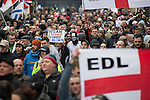 © Joel Goodman - 07973 332324 .  07/02/2015 . Dudley , UK . Approximately 500 EDL supporters march through Dudley town centre at an English Defence League demonstration in Dudley , in the West Midlands , this afternoon ( Saturday 7th February 2015 ). They oppose the building of a new mosque in Dudley . Photo credit : Joel Goodman