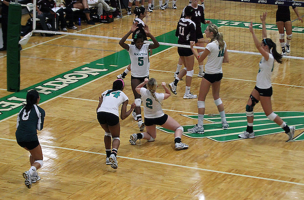 Denton, TX - SEPTEMBER 23: May Allen #2 of the University of North Texas Mean Green Volleyball and Carnae Dillard #5 celebrate a point against the University of Louisiana at Monroe at University of North Texas Volleyball Complex in Denton on September 23, 2012 in Denton, Texas. (Photo by Rick Yeatts)