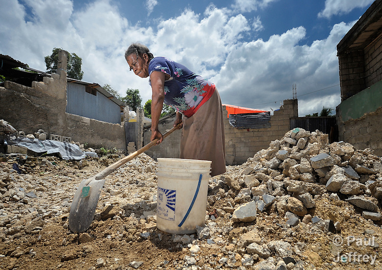 Andremeril Lamour, 81, clears rubble from where her house once stood in Carrefour, Haiti, until the 2010 earthquake knocked it to the ground. She is now finishing the rubble removal in order to make way for a new safe dwelling to be constructed with assistance from the United Methodist Committee on Relief (UMCOR).