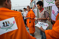 February 01, 2014 – Phnom Penh, Cambodia. Monks from the Independent Monk Network for Social Justice (IMNSJ) prepare to hold a ceremony in commemoration of the victims of garment clashes that took place in January 03, 2014. The IMNSJ and activists also called for the release of 23 detainees, arrested during the clashes and still held in pre-trial detention. © Nicolas Axelrod / Ruom