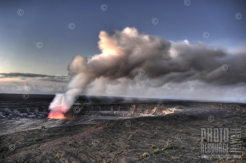 Pele's fire in Halema'um'au crater with rising volcanic ash cloud at Hawai'i Volcanoes National Park, Big Island of Hawai'i.