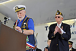 Parade Grand Marshall Everett Rosenblum, at podium, and parade cochair Adjustant Robert Tom Riordan, standing classping, at Merrick Memorial Day Ceremony on May 28, 2012, on Long Island, New York, USA. Rosenblum is a member of American Legion Merrick Post 1282. America's war heroes are honored on this National Holiday.