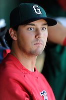 Pitcher Reed Reilly (33) of the Greenville Drive watches the action from the dugout during a game against the Charleston RiverDogs on Sunday, June 28, 2015, at Fluor Field at the West End in Greenville, South Carolina. Charleston won, 12-9. (Tom Priddy/Four Seam Images)