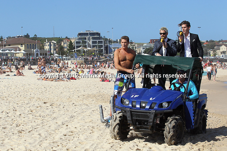 17/1/2012. Sydney, Australia...NON EXCLUSIVE..David Hasselhoff 'The Hoff' with fellow contestants from Celebrity Apprentice take to Bondi beach for some promo. 17/1/2012. Sydney, Australia...NON EXCLUSIVE..David Hasselhoff 'The Hoff' with fellow contestants from Celebrity Apprentice take to Bondi beach for some promo. ..*No internet without clearance*.MUST CALL PRIOR TO USE ..02 9211-1088.Matrix Media Group.Note: All editorial images subject to the following: For editorial use only. Additional clearance required for commercial, wireless, internet or promotional use.Images may not be altered or modified. Matrix Media Group makes no representations or warranties regarding names, trademarks or logos appearing in the images.