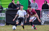 Dappy (Musician / Celebrity Big Brother) passes under pressure Mergim Butaja (The Apprentice 2015)  from during the SOCCER SIX Celebrity Football Event at the Queen Elizabeth Olympic Park, London, England on 26 March 2016. Photo by Andy Rowland.