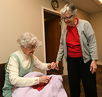 NWA Democrat-Gazette/ANDY SHUPE<br /> Bobbie Peters (left) sews a pocket Wednesday, March 15, 2017, as Ardith Wharry helps as they and other volunteers work to make sleeping bags for area homeless in the chapel at Butterfield Trail Village in Fayetteville. The group has made approximately 30 bags over the past few years using the &quot;My Brother's Keeper&quot; quilt group model, a national volunteer effort that promotes &quot;The Sleeping Bag Project.&quot;