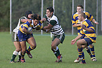 Male Sa'u has the attention of J. Davies and R. Koroi. Counties Manukau Premier Club Rugby, Patumahoe vs Manurewa played at Patumahoe on Saturday 6th May 2006. Patumahoe won 20 - 5.