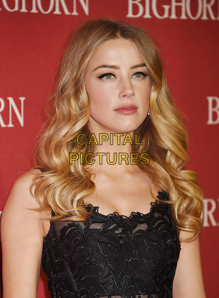 PALM SPRINGS, CA - JANUARY 02: Actress Amber Heard attends the 27th Annual Palm Springs International Film Festival Awards Gala at Palm Springs Convention Center on January 2, 2016 in Palm Springs, California.<br /> CAP/ROT/TM<br /> &copy;TM/ROT/Capital Pictures
