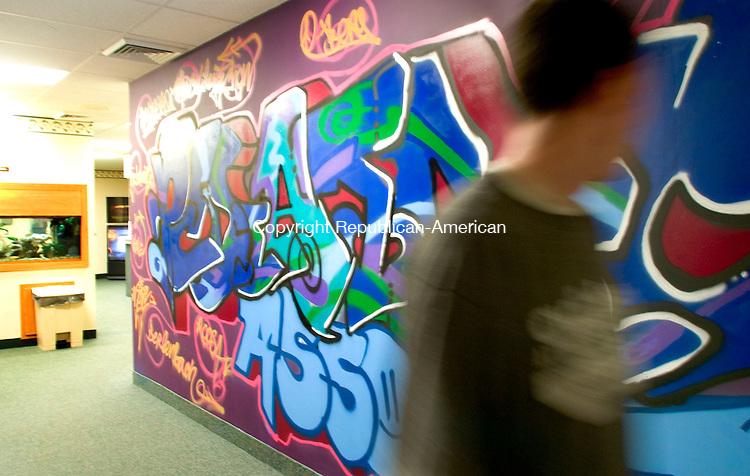 WATERBURY, CT- 15 MARCH 07- 031507JT01- <br /> A man walks by a mural created by graffiti artist Dan Cogan on a wall at Pediatric Associates in Waterbury on Thursday, March 15.<br /> Josalee Thrift Republican-American