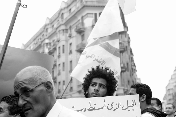 Egypt/ Cairo / 20.4.2012 / A young man protests in Talaat Harb Square on April 20th, when supporters of a variety of political groups, including Islamist, liberal and leftist forces, entered Tahrir Square to demonstrate against continuing military rule. April 20th, 2012. Cairo, Egypt.<br /> <br /> © Giulia Marchi