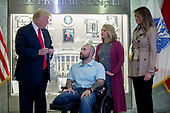 US President Donald J. Trump (L), with First Lady Melania Trump (R), talks with Sergeant First Class Alvaro Barrientos (2-L), with his wife Tammy Barrientos (2-R), prior to awarding the Purple Heart to him during a visit to Walter Reed National Military Medical Center in Bethesda, Maryland, USA, 22 April 2017. Sergeant First Class Alvaro Barrientos was recently injured in Afghanistan while deployed and for the wounds he sustained, he is receiving the Purple Heart.<br /> Credit: Shawn Thew / Pool via CNP