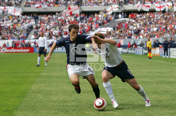 USA's Steve Cherundolo battles England's Joe Cole for the ball at Soldier Field in Chicago, IL, Saturday, May 28, 2005. England won 2-1.