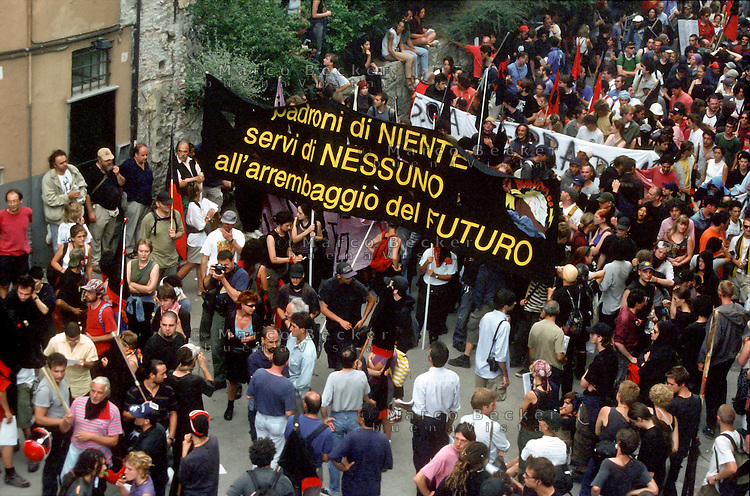 "genova luglio 2001, proteste contro il g8 --- genoa july 2001, protests against g8 summit ""masters of nothing, nobody's servants, rushing to the future"""