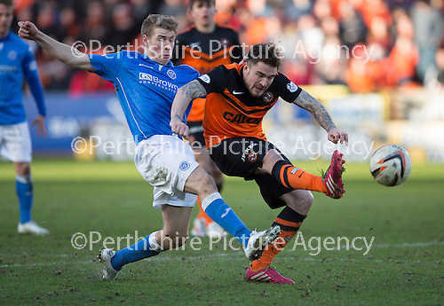 Dundee United v St Johnstone.....21.02.15<br /> Ryan Dow is tackled by David Wotherspoon<br /> Picture by Graeme Hart.<br /> Copyright Perthshire Picture Agency<br /> Tel: 01738 623350  Mobile: 07990 594431