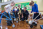 Children with disabilities playing indoor football. MR