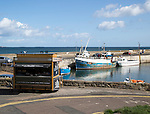 Boats in the harbour at Seahouses, Northumberland, England, UK
