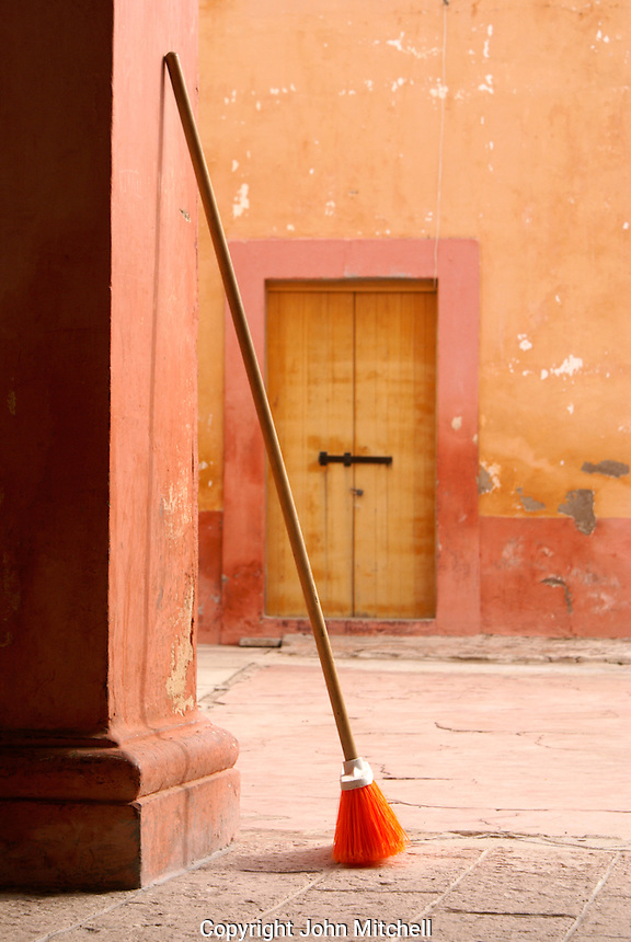 Broom and courtyard of the town hall in the 19th century mining town of Mineral de Pozos, Guanajuato, Mexico.