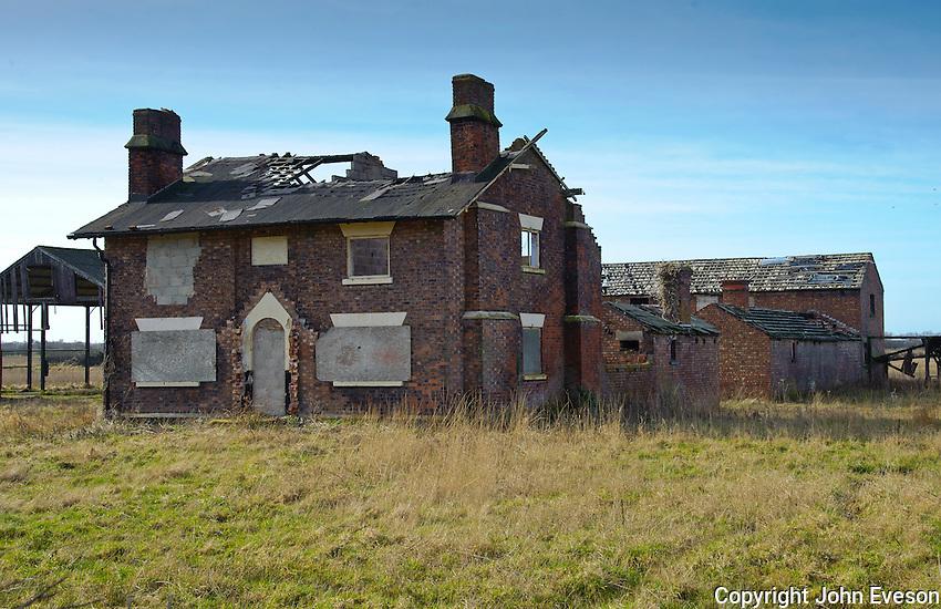 Derelict farm house and farm buildings at Burscough, South West Lancashire.
