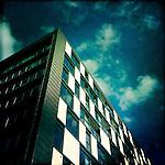 Loking up towards the sky at a modern building at Clarence Dock, Leeds, England