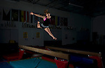 Ashleigh Mower shows off her gymnastics skills during an afterhours gym session at Gold Coast Gymnastics in Ventura, Calif., on Sunday March 31, 2013.