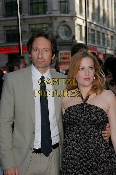 """DAVID DUCHOVNY & GILLIAN ANDERSON .Arrivals - """"The X-Files: I Want to Believe"""".UK  film premiere held at Empire Cinema, Leicester Square, London, England, 30th July 2008..X files half length pregnant dress black print halterneck tie white shirt beige grey suit jacket .CAP/AH.©Adam Houghton/Capital Pictures"""