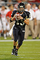 11 September 2010:  FIU quarterback Wesley Carroll (13) scrambles in the third quarter as the Rutgers Scarlet Knights defeated the FIU Golden Panthers, 19-14, at FIU Stadium in Miami, Florida.